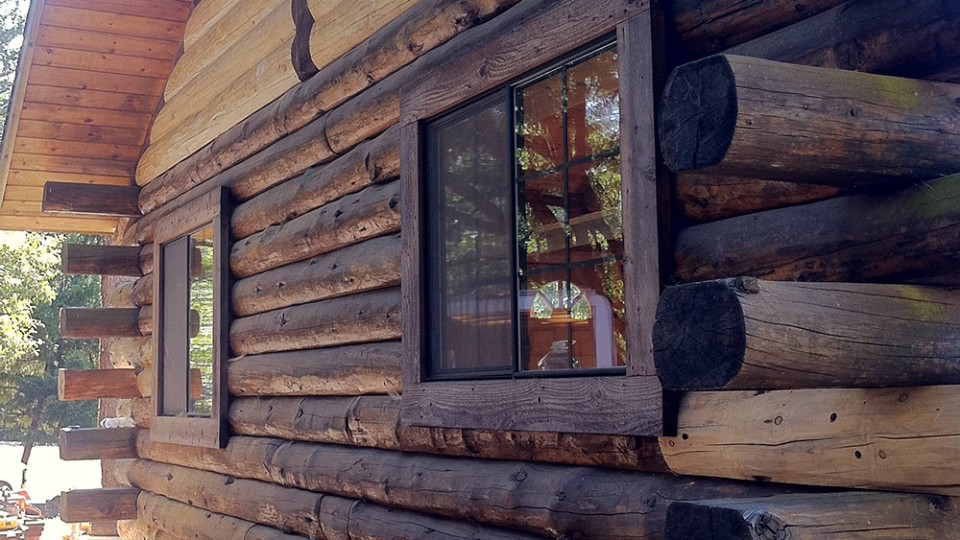 log home rot repair competed - view of side of home